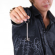 Young man holding keys in his hand — Stock Photo #6651915