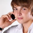 Portrait of young handsome man speaking on mobile phone — Stock Photo #6651925