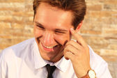Portrait of smiling businessman, thinking happy man on outdoors — Stock Photo