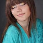 Beautiful girl in green oriental robe — Stock Photo