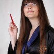 Japanese Geisha with red chopsticks — Stock Photo #6667393