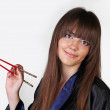 Japanese Geisha with red chopsticks — Stock Photo #6667401