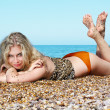 Young woman sunbathing on beach — Stock Photo #6668160
