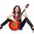 Sexy woman with guitar isolated on white background — Stock Photo