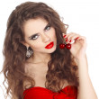 Sensual woman with red lips and dress playing with cherry — Stock Photo #6668886