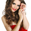 Stock Photo: Sensual woman with red lips and dress playing with cherry