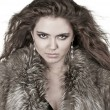 Beautiful woman in fur coat, fashion lady, curly hairstyle, wint — Stock Photo