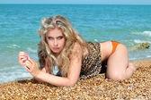 Sexy woman sunbathing on beach — Stock Photo