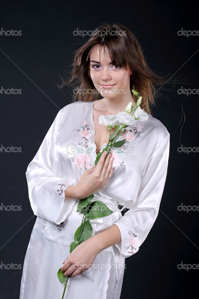 Spa, beautiful woman  in oriental robe with flowers — Stock Photo #6667170