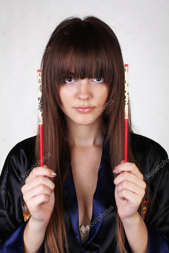 Woman with red chopsticks in hands isolated on white background — Stock Photo #6667413