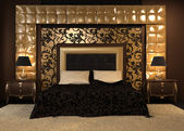 Front perspective of luxutiois double bed at royal apartment. Mo — Stock Photo