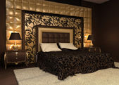 Romantic interior. Double bed in golden luxurious interior. Hote — Stock Photo