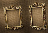 Empty golden frames on the wall. Space showroom. Royal — Stock Photo