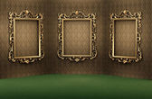 Empty golden frames on the wall in luxurious interior — Stock Photo