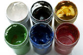 Used colorful paint buckets — Stock Photo