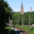 Railway road and church - Stock Photo