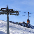 Chairlift in mountains - Stock Photo