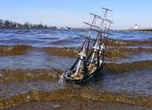 Model of sailing ship swimming in river — Stock Photo