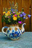 Bouquet in a teapot — Stock Photo