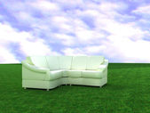 Sofa on a background a lawn — Stock Photo