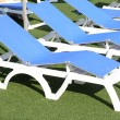 Deckchairs beside the swimming pool — Stock Photo