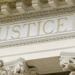 Justice word engraved - Stock Photo