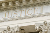 Justice word engraved — Stock Photo