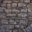 Grungy stone wall — Stock Photo
