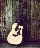 Acoustic guitar on wood. — Stock Photo