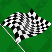 Race flag on green background with traces of tires — Stock Photo