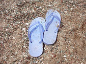 Beach sandals to the pebbly beach — Stock Photo