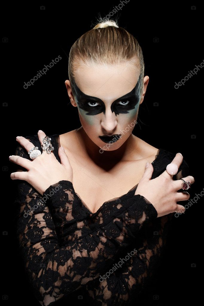 Vogue style portrait of a young woman with fantasy makeup on black background — Stock Photo #5380311