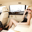 Lady in a luxury car — 图库照片