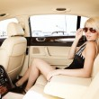 Lady in a luxury car — Stockfoto
