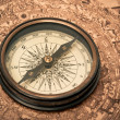 Antique Compass on Map - Stock Photo