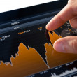 Analyzing Stock Market Chart - Stock Photo