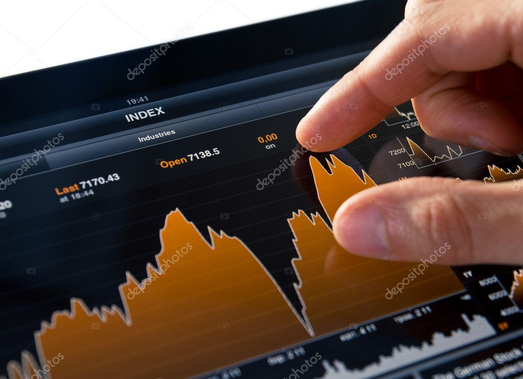 Analyzing stock market graph on a touch screen device.  Stock Photo #5997717