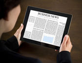 Reading Business News on Tablet PC — Stock Photo