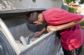 Young man in dumpster — Stock Photo