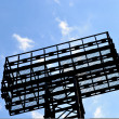 Construction on blue sky background . — Stock Photo