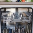 Stock Photo: Open dishwasher