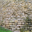 Old curved wall made of stone - Stock Photo