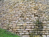 Old curved wall made of stone — Stock Photo