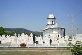 Orthodox church and cemetery — Stock Photo