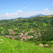 Beautiful views over the village from a high hill - Stock Photo