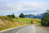 Haystack on the road in the Balkans — Stock Photo