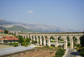 The old aqueduct in the city of Split — Stock Photo