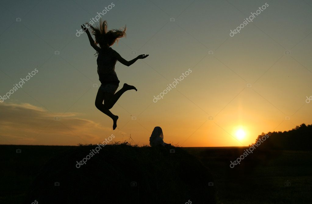 Woman silhouette at sunset — Stock Photo #6012952