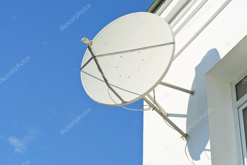 Satellite antenna on a house facade — Stock Photo #6172940