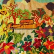 House and garden, embroidery - Stockfoto